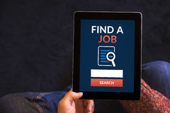 Hands holding tablet with find a job concept on screen Royalty Free Stock Photography