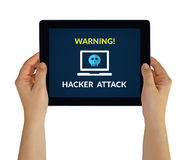 Hands holding tablet with hacker attack concept on screen Stock Images