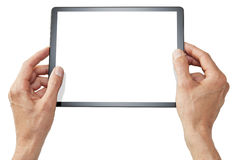 Hands Holding Tablet Isolated. Male hands holding a tablet computer device isolated on white Stock Images