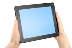 Hands holding a tablet Stock Photos