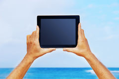 Hands holding a tablet Royalty Free Stock Images