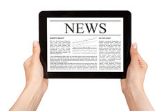 Hands holding tablet with news. Stock Image