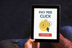 Hands holding tablet with Pay Per Click concept on screen Stock Photo