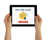 Hands holding tablet with Pay Per Click concept on screen. Hands holding digital tablet computer with Pay Per Click PPC concept on screen. Isolated on white. All royalty free stock photos