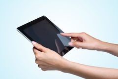 Hands holding a tablet pc. Stock Photos