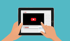 Hands holding tablet pc mockup with online video blog screen. Vlog concept. Vector illustration. Stock Photography