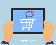 Hands holding Tablet PC screen showing on screen S. Hopping Cart Flat design Online Shopping concept and Computer Technology e-commerce concept in vector Royalty Free Stock Image