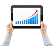 Hands Holding Tablet PC With Success Chart. Hands are holding the tablet pc with success chart on a screen. Isolated on white Stock Photo