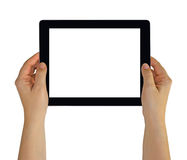 Hands holding a tablet pc with white blank empty screen Royalty Free Stock Image