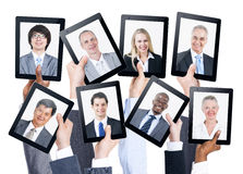 Hands Holding Tablet with People Face on it Stock Photography