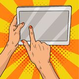 Hands holding a tablet pop art. Female hands with red manicure hold a laptop computer. Vintage pop art retro vector. Illustration. EPS 10 Royalty Free Stock Image