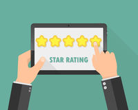 Hands holding a tablet with rating stars. Vector illustration Stock Image