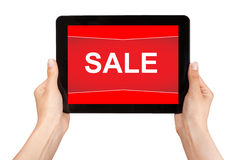 Hands holding a tablet with sale on a red screen Royalty Free Stock Images