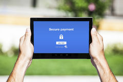 Hands holding tablet. Secure payment on the screen. Royalty Free Stock Photos