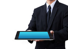 Hands holding a tablet touch computer gadget Royalty Free Stock Images