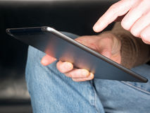 Hands holding Tablet Stock Images