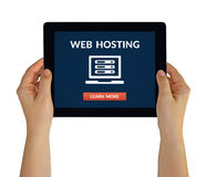 Hands holding tablet with web hosting concept on screen Stock Photos