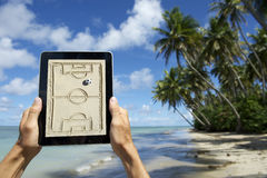 Hands Holding Tactics Board on the Beach Bahia Brazil Stock Image