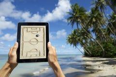 Hands Holding Tactics Board on the Beach Bahia Brazil. Hands holding football tactics board tablet on the beach in Nordeste Bahia Brazil Stock Image