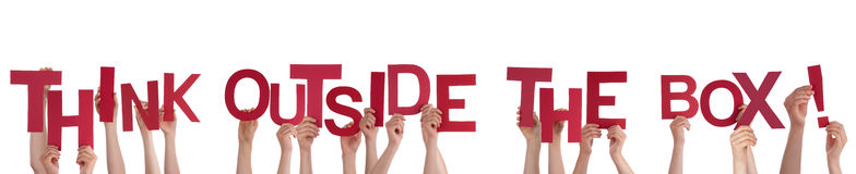 Hands Holding Think Outside the Box. Many Hands Holding the Words Think Outside the Box, Isolated Stock Photography