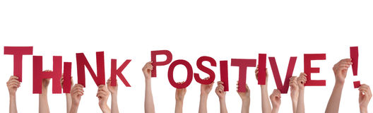 Hands Holding Think Positive. Many Hands Holding the Words Think Positive, Isolated Stock Image