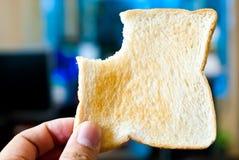 Hands holding toast Stock Photos
