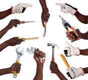 Hands holding tools Royalty Free Stock Image