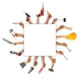 Hands holding tools on white background. Hands holding hand tools on white background Stock Photo