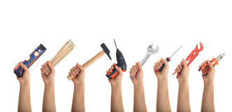 Hands holding tools on white background. Hands holding hand tools on white background Royalty Free Stock Images