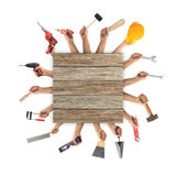 Hands holding tools on white background. Hands holding hand tools on white background Stock Photography