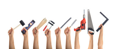 Hands holding tools on white background. Hands holding hand tools on white background royalty free stock image