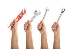 Hands holding tools on white background. Hands holding hand tools on white background royalty free stock photo