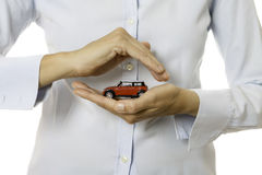 Hands holding a toy car Royalty Free Stock Photo