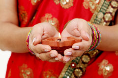 Hands holding A traditional Indian oil lamp Royalty Free Stock Photo