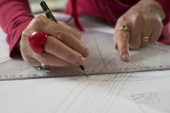 Hands Holding Triangle Ruler and Pen Tracing Paper Royalty Free Stock Photos