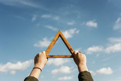Hands Holding Triangle Symbol Cloudscape Concept Stock Photos