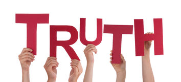 Hands Holding Truth. Many Hands Holding the Red Word Truth, Isolated royalty free stock image
