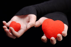 Hands holding two hearts Stock Image