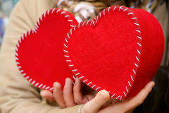 Hands that holding two hearts Royalty Free Stock Images