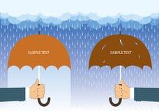 Hands holding umbrellas under big rain. Royalty Free Stock Photos