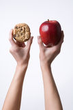 Hands holding up an apple and  Stock Photography