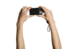 Hands holding up camera Royalty Free Stock Photo