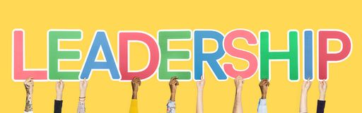 Hands holding up colorful letters forming the word leadership stock images