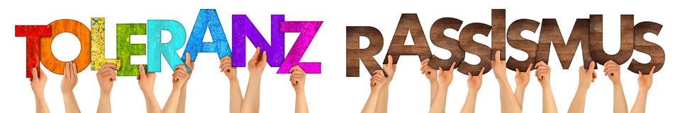 Hands holding up colorful wood letter Toleranz Rassismus Royalty Free Stock Photos