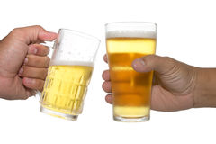 Hands holding up a glass of beer Stock Image