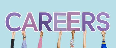 Hands holding up purple letters forming the word careers stock images
