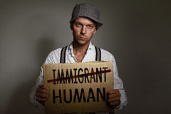 Immigrant holding up sign Royalty Free Stock Images