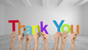 Hands holding up thank you. In grey room stock video footage