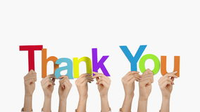 Hands holding up thank you. On white background stock footage