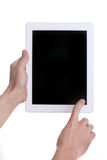 Hands Holding and Using a Tablet Touch Computer Gadget Royalty Free Stock Photo